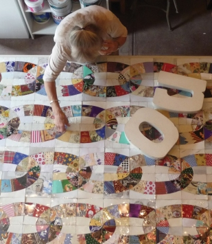 """Janet De Berge Lange at work in her studio on """"No,"""" a traditional quilt pattern made from untraditional materials"""